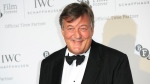 Stephen Fry poses for photographers upon arrival at the British Film Institute London Film Festival Gala Dinner in central London on Tuesday, Oct. 7, 2014. ( John Phillips / Invision )