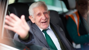 This is a June 7, 2014 file photo of Bernard Jordan, the war veteran found in Normandy after being reported missing from his care home. A British nursing home said an ex-naval officer who gained attention after vanishing from his care facility and taking an impromptu bus ride to France to attend D-Day commemorations has died. Bernard Jordan was 90. Gracewell Healthcare confirmed Jordan's death on Tuesday Jan. 6, 2015. (AP Phto/Chris Ison/PA, File)