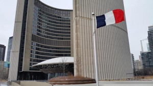 The French flag is seen flying at city hall in Toronto on Thursday, Jan., 2014. (Twitter/Norm Kelly)