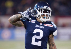 Toronto Argonauts' Chad Owens gestures to the crowd after gaining some running yards during first half CFL action against the Edmonton Eskimos in Toronto on Oct. 4, 2014. (The Canadian Press/Peter Power)
