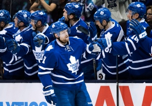 Toronto Maple Leafs' Phil Kessel celebrates his goal with teammates during first period NHL hockey action against the Columbus Blue Jackets in Toronto on Friday, Jan. 9, 2015. (The Canadian Press/Darren Calabrese)