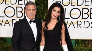 George Clooney, left, and Amal Clooney arrive at the 72nd annual Golden Globe Awards at the Beverly Hilton Hotel in Beverly Hills, Calif., Sunday, Jan. 11, 2015. (Photo by Jordan Strauss / Invision)