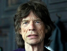 Mick Jagger attends the L�Wren Scott Fall 2012 show during Fashion Week in New York, Thursday, Feb. 16, 2012. (AP Photo/Richard Drew)