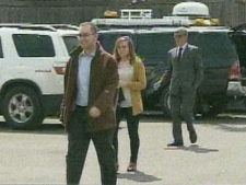 Toronto Star Reporter Daniel Dale (left) walks into 22 Division Thursday afternoon. (CP24)