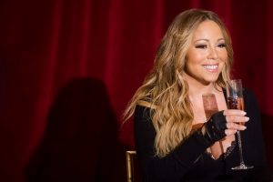 Mariah Carey attends the launch of her Go N'Syde Butterfly beverage on Monday, June 9, 2014, in New York. (Photo by Charles Sykes/Invision/AP)