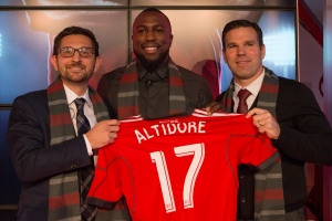 Jozy Altidore, centre, poses for a photo with Toronto FC's General Manager Tim Bezbatchenko, left, and Head Coach Greg Vanney following a news conference where he was introduced as Toronto FC's latest signing in Toronto on Friday, January 16, 2015. The USA international forward was signed in a deal which saw Jermain Defoe transferred to Altidore's previous club Sunderland from the EPL. THE CANADIAN PRESS/Chris Young
