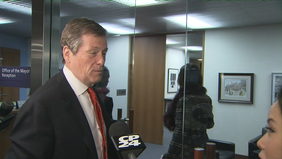 Mayor John Tory arrives at his city hall office on Tuesday morning.