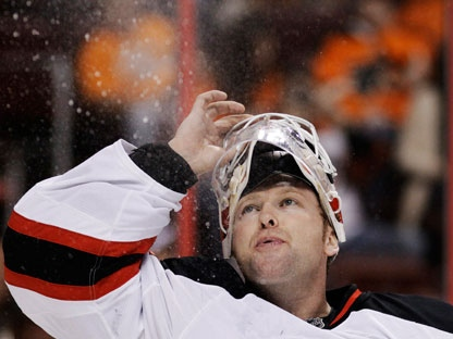 New Jersey Devils goalie Martin Brodeur blows water into the air before the second period of Game 5 of a second-round NHL hockey Stanley Cup playoff series against the Philadelphia Flyers on Tuesday, May 8, 2012, in Philadelphia. (AP Photo/Matt Slocum)