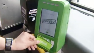 A passenger uses a Presto card reader in Toronto.