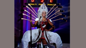 Miss Canada, Chanel Beckenlehner, poses for the judges, during the national costume show during the 63rd annual Miss Universe Competition in Miami, Fla., Wednesday, Jan. 21, 2015. (AP Photo/J Pat Carter)