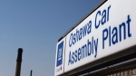 In this Monday, Sept. 17, 2012, file photo, a sign stands outside Oshawa's General Motors car assembly plant in Oshawa, Ont. (AP Photo/The Canadian Press, Michelle Siu)