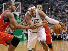 Boston Celtics small forward Paul Pierce (34) loses control of the ball as Philadelphia 76ers power forward Lavoy Allen, left, pressures on a drive to the basket during the second quarter of Game 2 in their NBA basketball Eastern Conference semifinal playoff series in Boston on Monday, May 14, 2012. (AP Photo/Charles Krupa)