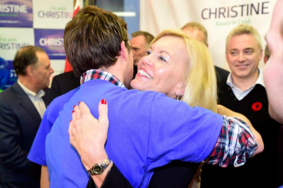 Christine Elliott hugs one hof her sons after announcing her bid to run for the Ontario PC leadership in Toronto on Saturday, Nov. 8, 2014. (The Canadian Press/Frank Gunn)