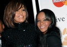 In this Feb. 12, 2011, file photo, singer Whitney Houston, left, and daughter Bobbi Kristina Brown arrive at an event in Beverly Hills, Calif. (AP /Dan Steinberg)