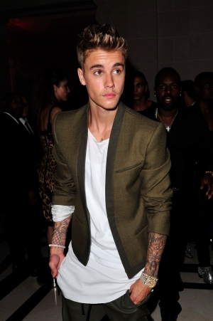 Justin Bieber leaves Carine Roitfeld & Stephen Gan celebration of the launch of CR Fashion Book N.5 in Paris, Tuesday, Sept. 30, 2014.(AP /Zacharie Scheurer)