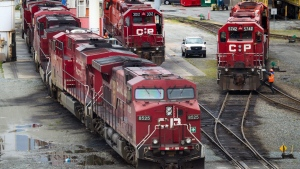 A Canadian Pacific Rail maintenance worker climbs onto a locomotive east of Vancouver, B.C., on Wednesday, May 23, 2012. (Darryl Dyck / THE CANADIAN PRESS)