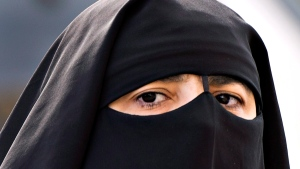 A woman wears a niqab as she walks Monday, September 9, 2013 in Montreal. (Ryan Remiorz / The Canadian Press)