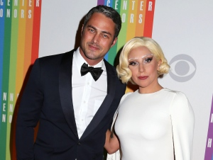 In this Dec. 7, 2014 file photo, Taylor Kinney and Lady Gaga attend the 37th Annual Kennedy Center Honors in Washington. (Greg Allen/Invision/AP)
