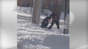 The assault of a police officer in Brampton is seen in this image captured from a video.