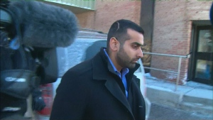 Toronto cops charged with sexually assaulting a female officer walk out of a Finch Avenue courthouse on Feb. 19, 2015 after being released on $15,000 bail.