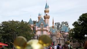 In this Jan. 22, 2015 file photo, visitors walk toward the Sleeping Beauty's Castle in the background at Disneyland Resort in Anaheim, Calif. (AP /Jae C. Hong)
