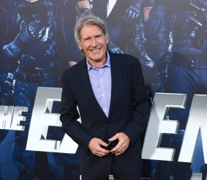 "In this Aug. 11, 2014 file photo, Harrison Ford arrives at the premiere of ""The Expendables 3"" at TCL Chinese Theatre in Los Angeles. (Photo by Jordan Strauss/Invision/AP)"