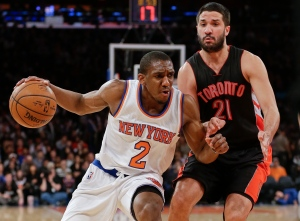 New York Knicks' Langston Galloway (2) drives past Toronto Raptors' Greivis Vasquez (21) during the second half of an NBA basketball game Saturday, Feb. 28, 2015, in New York. The Knicks won the game 103-98. (AP Photo/Frank Franklin II)