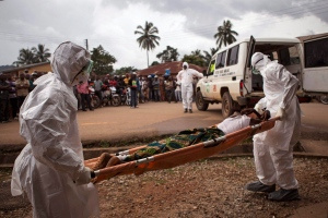 In this Wednesday, Sept. 24, 2014 file photo, healthcare workers load a man suspected of suffering from the Ebola virus onto an ambulance in Kenema, Sierra Leone. Sierra Leone's vice-president has put himself in quarantine following the death from Ebola of one of his security guards. (AP Photo/ Tanya Bindra, File)