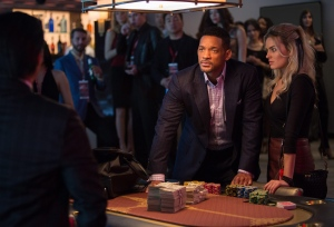 "In this image released by Warner Bros. Pictures, Will Smith, center, and Margot Robbie, right, appear in a scene from the film, ""Focus."" (AP Photo/Warner Bros. Pictures, Frank Masi)"