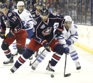 Columbus Blue Jackets' Tim Erixon (10) keeps the puck away from Toronto Maple Leafs' Richard Panik (12), of the Czech Republic, in the second period of an NHL hockey game, Friday, Oct. 31, 2014, in Columbus, Ohio. (AP Photo/Mike Munden)