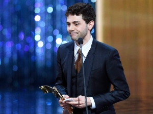 """Xavier Dolan holds his award for best director for a film at the Canadian Screen Awards in Toronto on Sunday evening, March 1, 2015. Dolan won for """"Mommy."""" (Frank Gunn /The Canadian Press)"""