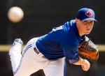 Toronto Blue Jays starting pitcher Aaron Sanchez warms up before playing against the Pittsburgh Pirates in Grapefruit League baseball action in Dunedin, Fla., on Tuesday, March 3, 2015. (The Canadian Press/Nathan Denette)