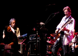 In this Feb. 4, 2008 file photo, Phil Lesh, right, performs during a fundraising concert in San Francisco while Grateful Dead band mate Bob Weir, standing at left, looks on. (AP Photo/Noah Berger)