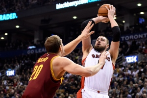 Toronto Raptors' Jonas Valanciunas shoots as Cleveland Cavaliers' Timofey Mozgov (20) defend during first half NBA basketball action in Toronto on Wednesday, March 4, 2015. (The Canadian Press/Frank Gunn)