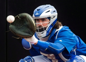 Toronto Blue Jays catcher Jack Murphy catches a bullpen session during baseball spring training in Dunedin, Fla., on Monday, February 23, 2015. THE CANADIAN PRESS/Nathan Denette