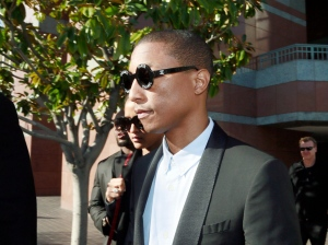 "Pharrell Williams leaves Los Angeles Federal Court after testifying at trial in Los Angeles, Wednesday, March 4, 2015. The Grammy-winning singer Williams says he wasn't trying to copy the late Marvin Gaye's music for the hit song ""Blurred Lines,"" but he was trying to evoke the feeling of late 1970s tunes. Williams is being sued by Gaye's children, who claim ""Blurred Lines"" improperly copies their father's hit ""Got to Give it Up."" Singer Robin Thicke and rapper T.I. are also defendants in the case. (AP Photo/Nick Ut)"