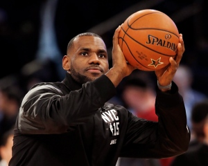 East Team's LeBron James, of the Cleveland Cavaliers, shoots a basket prior to the start of the NBA All-Star basketball game, Sunday, Feb. 15, 2015, in New York. (AP Photo/Kathy Willens)