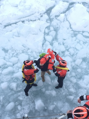 In a photo provided by the crew of Coast Guard Cutter Neah Bay, home-ported in Cleveland, Ohio, rescues a 25-year-old man attempting to walk across Lake St. Clair, March 5, 2015. The crew is transporting the man, a U.S. citizen who was hypothermic, back to shore in Algonac, Mich., where they will be met by emergency medical services. (AP Photo/U.S. Coast Guard, Lt. Josh Zike)