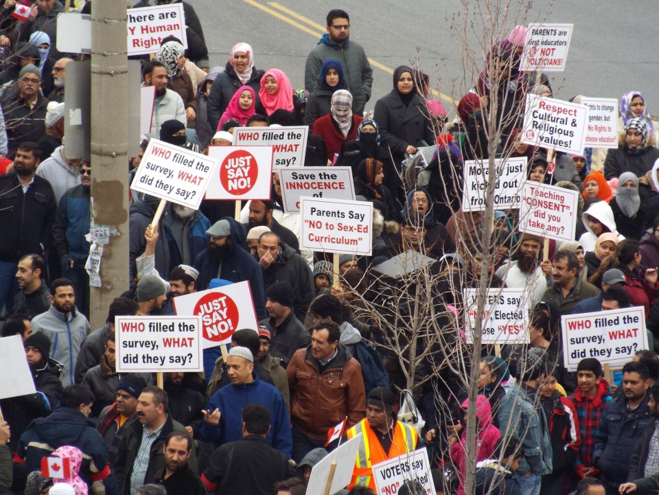 People take part in a protest against the Ontario government's new sex education curriculum in Thorncliffe park Saturday March 14, 2015. (Nathaniel Snow /submitted)