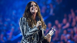 Artist Alanis Morissette receives her achievement from the Canadian Music Hall of Fame during the 2015 Juno Awards in Hamilton, Ont., on Sunday, March 15, 2015. (Nathan Denette / THE CANADIAN PRESS)
