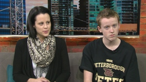 Odin Camus (right) and his mom Melissa Camus sit down for an interview with Stephen LeDrew on CP24 Monday March 23, 2015.