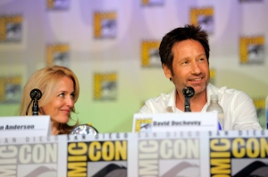 "Gillian Anderson, left, and David Duchovny attend the ""The X Files"" 20th Anniversary panel on Day 2 of Comic-Con International on Thursday, July 18, 2013 in San Diego, Calif. (Photo by Chris Pizzello/Invision/AP)"
