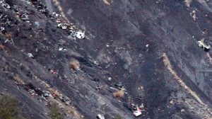 Debris of the Germanwings passenger jet is scattered on the mountain side near Seyne les Alpes, French Alps, Tuesday, March 24, 2015. (AP Photo/Claude Paris)
