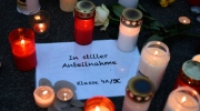 "Candles sit on a paper reading ""in silent memory, class 9a/9c"" in front of the Joseph-Koenig Gymnasium in Haltern, western Germany Tuesday, March 24, 2015. A Germanwings plane from Barcelona crashed on its way to Duesseldorf over the French alps, 16 school children and 2 teachers from Haltern were among the 150 people on board. (AP Photo/Martin Meissner)"