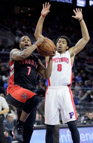 Toronto Raptors' Kyle Lowry (7) goes to the basket against Detroit Pistons' Spencer Dinwiddie (8) during the first half of an NBA basketball game Tuesday, March 24, 2015, in Auburn Hills, Mich. (AP Photo/Duane Burleson)