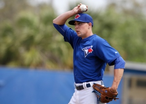 Toronto Blue Jays starting pitcher Aaron Sanchez holds the ball over his head during the fifth inning of an exhibition baseball game against the Philadelphia Phillies in Dunedin, Fla., on Thursday, March 26, 2015. (AP Photo/Kathy Willens)