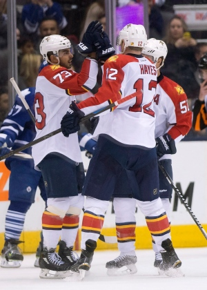 Florida Panthers centre Brandon Pirri (73) is congratulated on his goal against the Toronto Maple Leafs by teammates Jimmy Hayes (12) and Brian Campbell (51) during second period NHL action in Toronto on Thursday, March 26, 2015. (The Canadian Press/Frank Gunn)