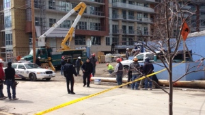 One person is dead and another has been seriously injured after a construction accident in High Park on Friday, March 27, 2015. (Nathan Downer/ CP24)