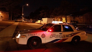 A police cruiser is shown at the scene of a shooting on Jamestown Crescent late Monday night. (John Hanley)