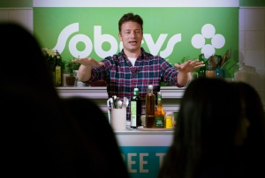 British chef Jamie Oliver does a cooking demonstration for children during a press conference at a Sobeys location in Toronto on Wednesday, Oct. 1, 2014. (The Canadian Press/Darren Calabrese)
